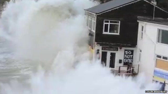 Wave crashing over restaurant