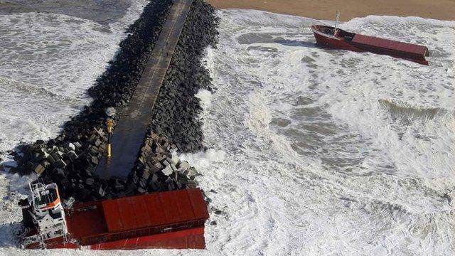 An aerial view show waves which break against a Spanish cargo ship carrying fertiliser, broken in two, off the beach in Anglet on the Atlantic Coast of France