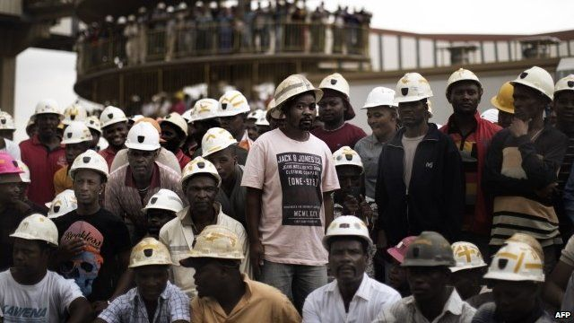 Miners gather to mourn after fire