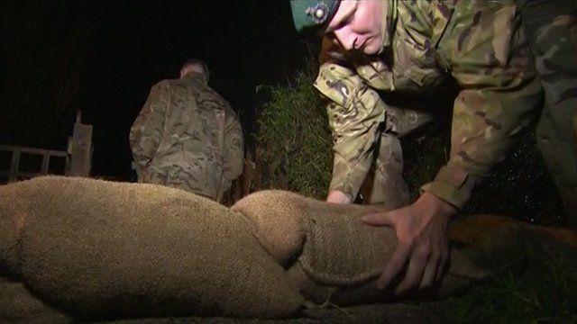 Marines laying sandbags in Somerset