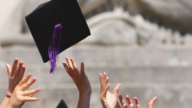 Graduates throw up hats