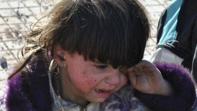A Syrian child cries in the city of Homs. Photo: 12 February 2014