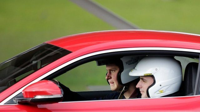 Prince Harry drives red car