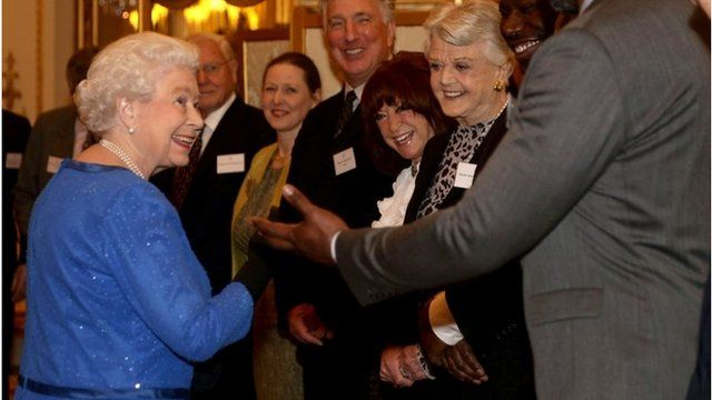 The Queen meets her guests at Buckingham Palace
