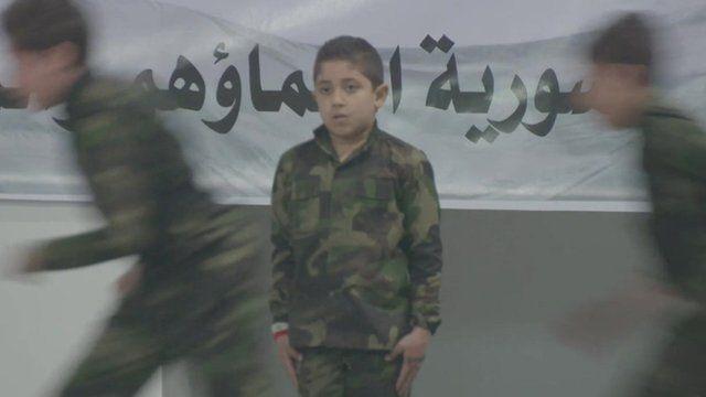 Young Syrian boys in army uniform