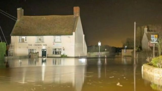 The Crown Inn surrounded by flood water