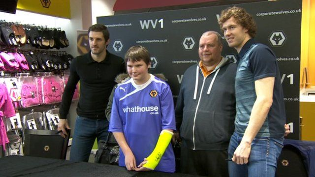 Captain Sam Ricketts [left] and midfielder Kevin McDonald meeting fans