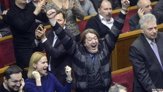 Ukraines opposition members react during a Parliament session in Kiev
