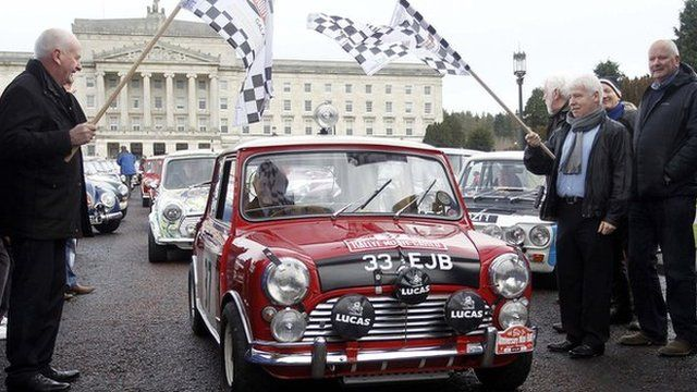 Paddy Hopkirk led a cavalcade of cars in his red Mini Cooper