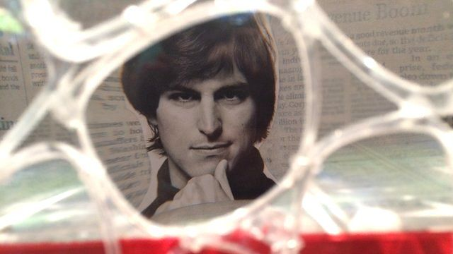 Photograph of Steve Jobs appearing in an interactive art installation.