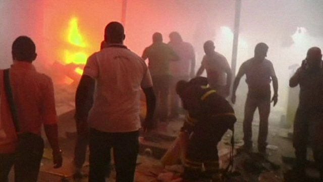 Rescue workers and locals at the scene of the explosion