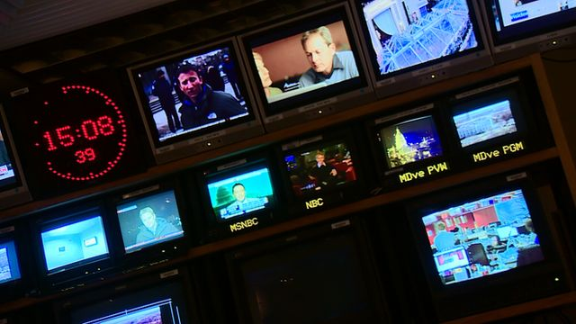 A wall of television screens