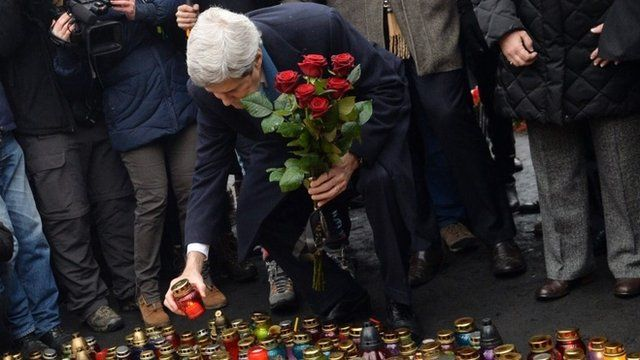 John Kerry places candle and flowers in memory of protesters killed in Kiev