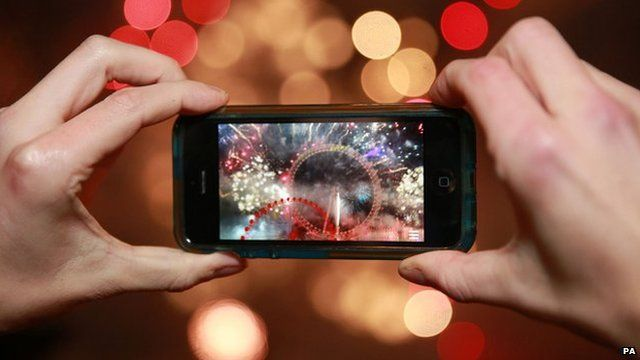 A person taking a photograph on a smartphone