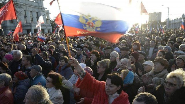 Pro-Russian demonstrators take part in a rally in the Crimean town of Yevpatoria on 5 March 2014