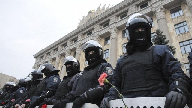 Riot police stand guard in front of regional government building as pro-Russian demonstrators take part in a rally in Kharkiv