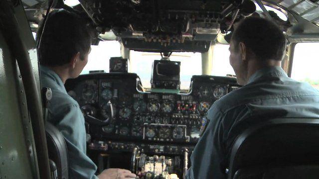 Vietnamese search and rescue crew in plane cockpit