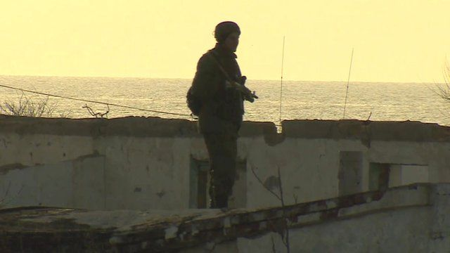 Russian soldier stands guard at Ukraine air missile base