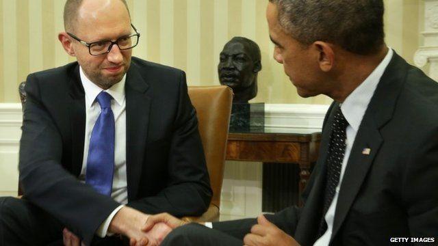 President Barack Obama (R) shakes hands with Prime Minister of Ukraine Arseniy Yatsenyuk