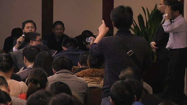 A relative of one of the Chinese passengers on board Malaysia Flight MH370 shows his frustration at a press conference by Malaysia Airlines