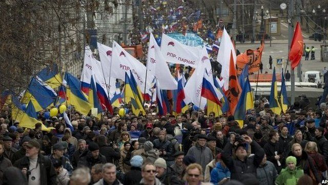 Demonstrators carrying Russian and Ukrainian flags march to oppose President Vladimir Putin's policies in Ukraine, in Moscow.