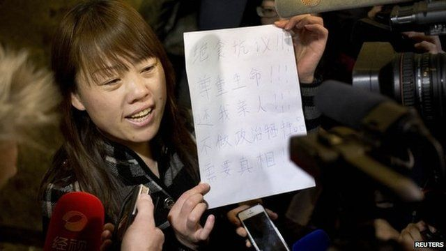 "A relative of a Chinese passenger aboard the missing Malaysia Airlines Flight MH370 shows a paper reading ""Hunger strike protest, Respect life, Return my relative, Don't want become victim of politics, Tell the truth"""
