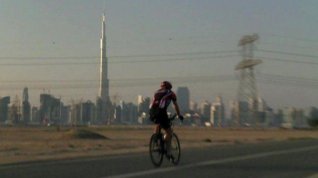 man cycling in Dubai