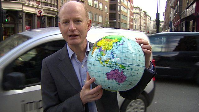 Simon Gompertz with globe