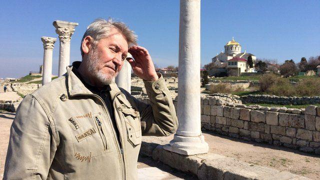 Man looking at ruins