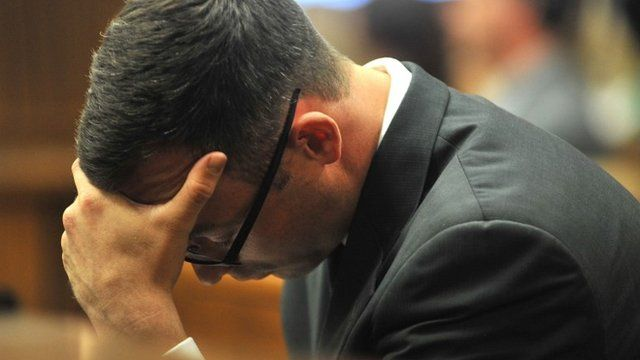 Oscar Pistorius holds his head in his hands as he listens to evidence being given in court in Pretoria, South Africa, Monday March 24, 2014