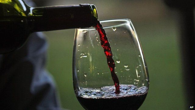 Man pours a glass of wine