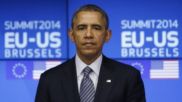 U.S. President Barack Obama looks on as he takes part in a EU-US summit in Brussels March 26, 2014
