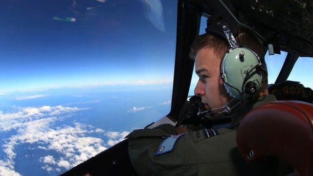 A flight lietenant looks out of the cockpit of an RAAF aircraft