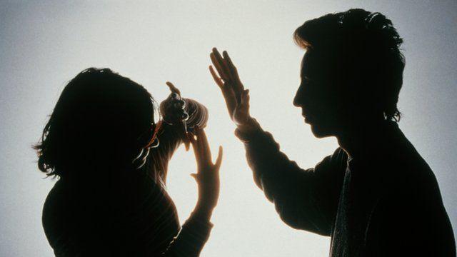 Man striking woman