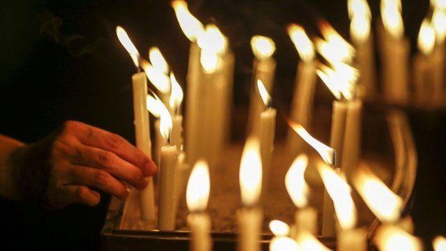 Candles at a vigil in Kuala Lumpur
