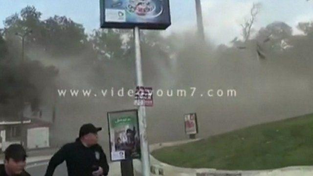 Men run from explosion in Cairo