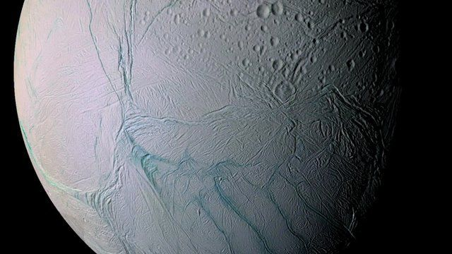 Saturn's Enceladus moon with 'tiger stripes' containing water