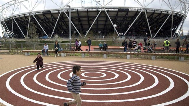 Children play in a playground, in front of the Olympic Arena, in the Queen Elizabeth Olympic Park in East London April 5, 2014