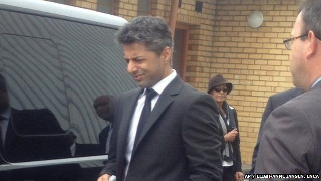 Shrien Dewani arrives at the airport in Cape Town