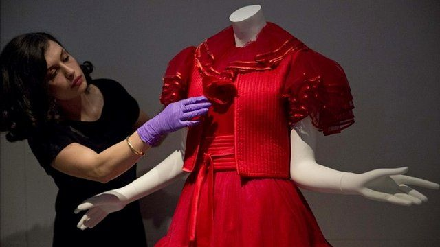 Assistant curator Lucia Savi with Valentino dress from 1977