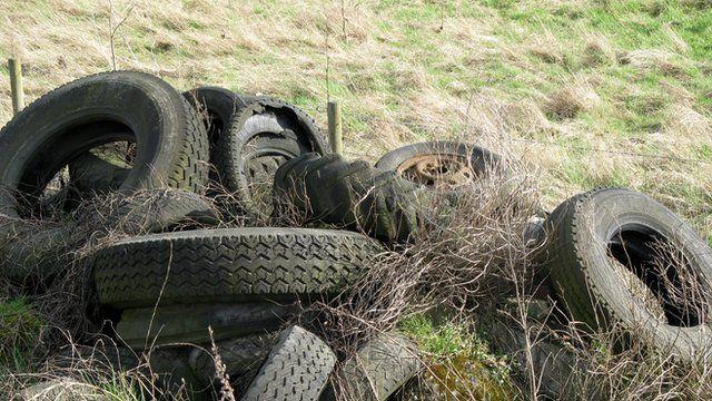 Tyres dumped in a farmer's field
