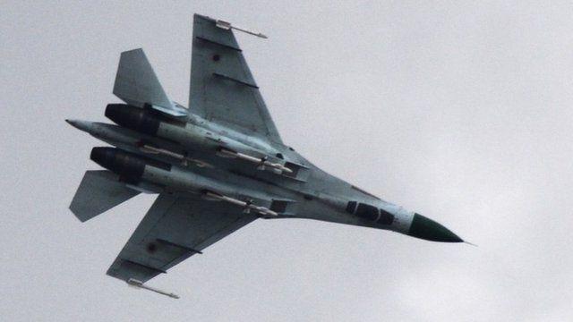 Ukrainian air force Su-27 fighter jet is in the sky outside Slovyansk