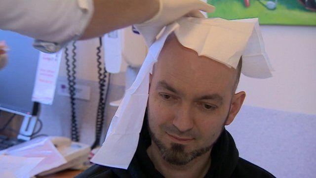 Alex Lewis-Mayhew receiving treatment