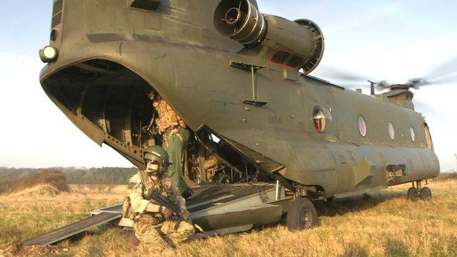 Soldier and Chinook helicopter