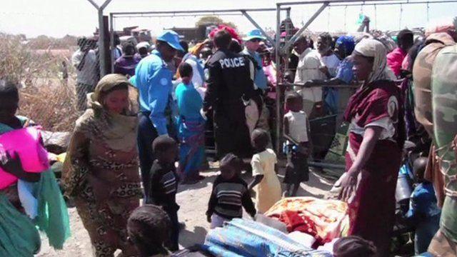 Refugees at camp gates
