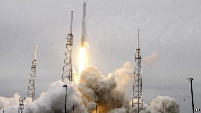 A rocket carrying the SpaceX Dragon ship lifts off from launch complex 40 at the Cape Canaveral Air Force Station in Cape Canaveral