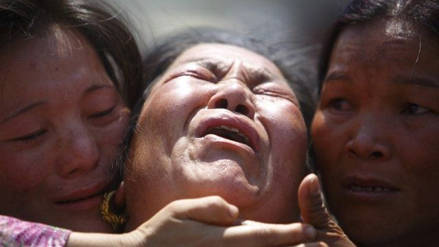 A family member a Sherpa climber is comforted by her relatives during a funeral rally of Nepali Sherpa climbers in Kathmandu April 21,