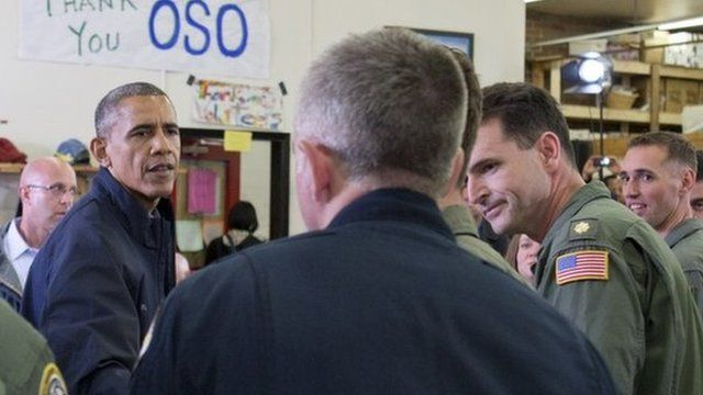 President Barack Obama greets responders recovery workers and community members at the Oso Fire Department in Oso, Wash.,