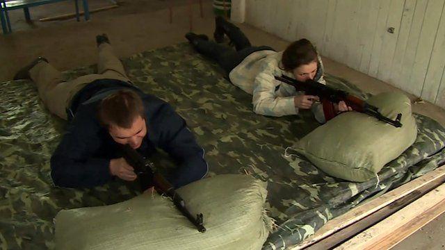 Ukrainian civilians training to use firearms