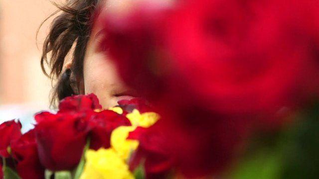 Syrian refugee children on the streets of Lebanon selling flowers
